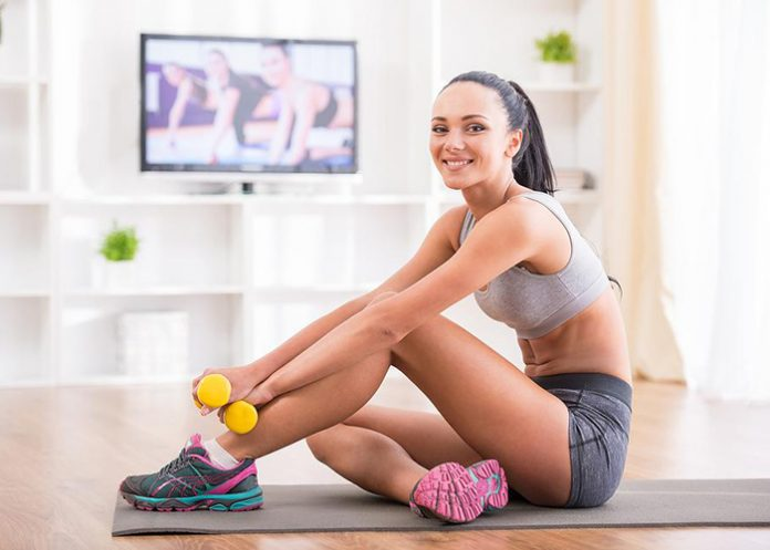 Fit woman does home workouts