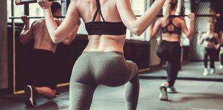 Sportswoman doing squats for inner thighs