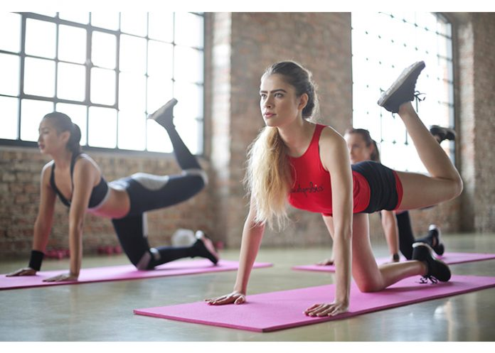 Women exercising in a pilates class
