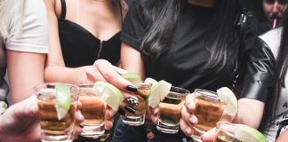 Young girls drinking alcohol