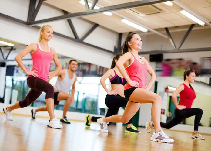 Fit young women doing aerobics